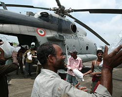 The Indian government has sent in thousands of troops, helicopters and boats to help with the rescue effort