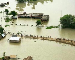 People reach for safer places in the flood affected area of Saharsa, near River Kosi in north Bihar